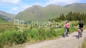 Couple riding their mountain bikes