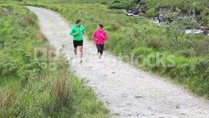 Fit couple jogging together on a trail