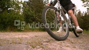 Athletic couple mountain biking in the countryside together