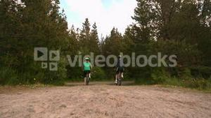 Fit couple mountain biking in the countryside together away from camera