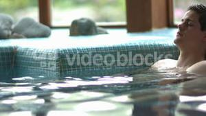Attractive couple relaxing in swimming pool
