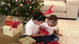 Animation of two children opening their present