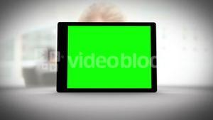 Tablet with green screen in front of business people