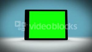 Tablet with green screen on changing background