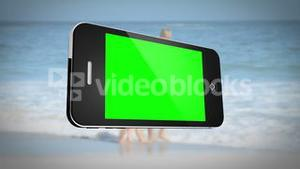 Smartphone with green screen in front of family outdoors