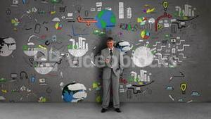 Businessman standing in front of animated business flowcharts