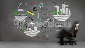 Businessman sitting in front of animation of global influences