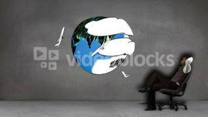 Businessman sitting in front of animated planes circling earth