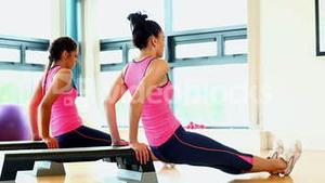 Young toned women training their arms