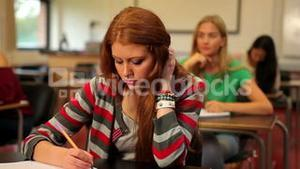 Blonde student thinking in class