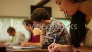 Concentrating students having an exam in a classroom