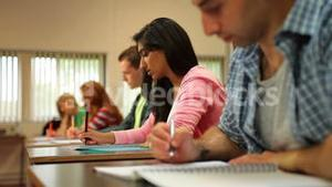 Concentrating students taking notes in class