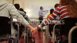Students holding hands in class