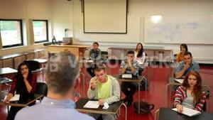 Students listening intently to their teacher in class