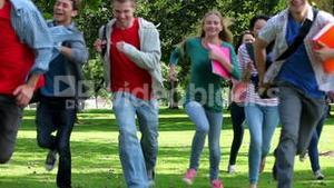 Students running towards camera together