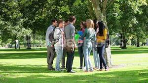 Students flirting together outside