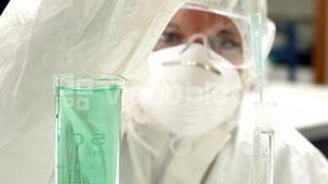 Science student in protective suit working with chemicals