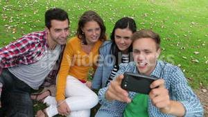 Students taking a selfie on the grass