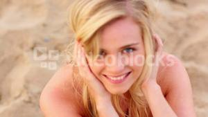 Blonde beauty smiling up at camera