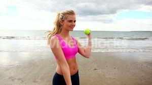Fit blonde lifting with dumbbells