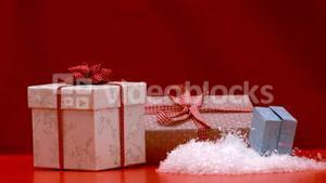 Christmas present falling and bouncing on red background