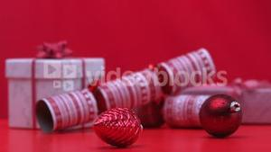 Christmas decorations spinning beside crackers and presents