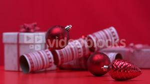 Christmas decorations spinning and falling beside crackers and presents