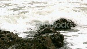 Waves covering rocks at the coast