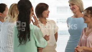 Businesswoman standing and chatting