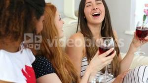 Content calm women drinking glass of wine