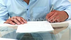 Young businessman signing a contract