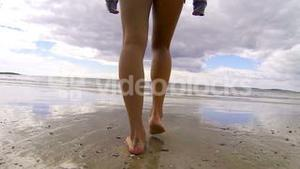 Fit woman walking into the sea