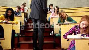 Lecturer supervising an exam in lecture hall