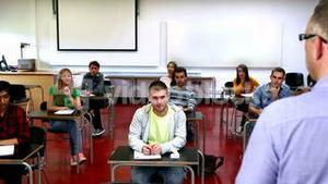 Lecturer speaking to his class