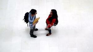 Two students meeting in the hallway