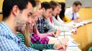 Row of students listening in a lecture hall
