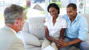 Salesman talking to customers on the couch
