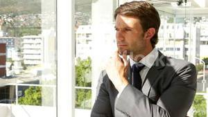 Thoughtful businessman looking out window