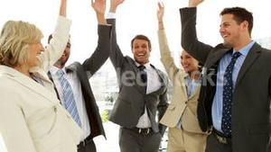 Business people putting hands together and giving thumbs up