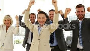 Business people cheering at the camera