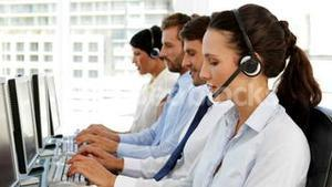 Happy call centre agent looking to camera