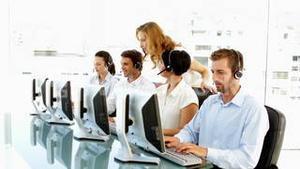 Supervisor checking on call centre employees