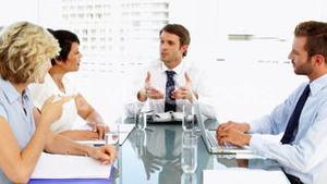 Business people listening to their boss during meeting