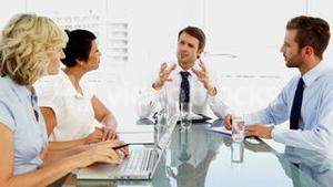 Business people talking with their boss during meeting