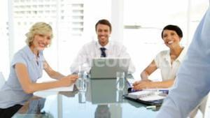 Business people smiling at camera during a meeting