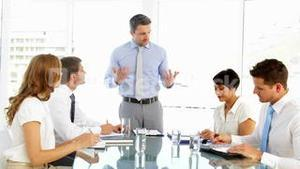 Businessman standing and talking during meeting