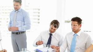 Businessman presenting to his staff during meeting