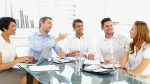 Happy business team discussing during meeting