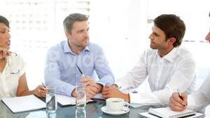 Happy business team chatting during meeting
