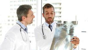 Serious doctors studying an xray